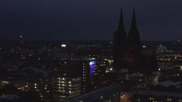 AERIAL: Wide Shot of Cologne Germany From the Air with Majestic Cathedral at Night