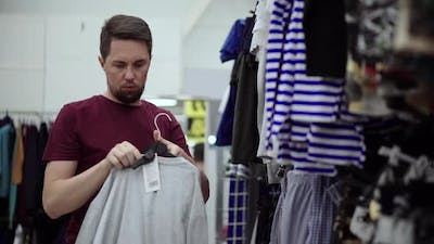 Man Buying Casual Clothes