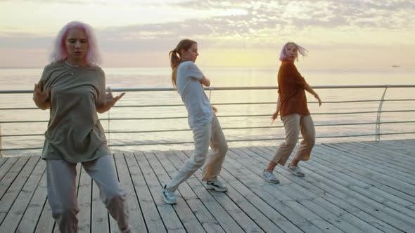 Young Dancing Teenager Girls Enjoying Funky Hip-hop Moves. Modern Women Performing Freestyle Dance