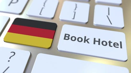BOOK HOTEL Text and Flag of Gemany on the Keyboard