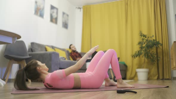 Sporty Woman Doing Home Workout on Yoga Mat