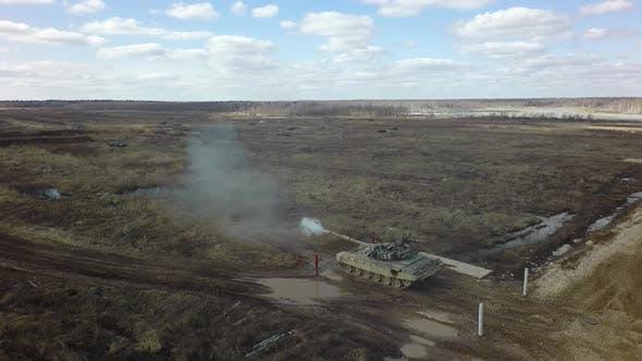 A tank shoots at a shooting range