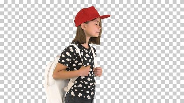 Happy Asian schoolgirl with backpack walking, Alpha Channel