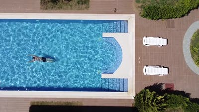 Man Swimming in the Pool Top Down View