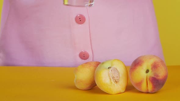 Thumbnail for Glass of Freshly Squeezed Juice Is Placed on the Table. Fresh Peach Juice, Proper Nutrition.