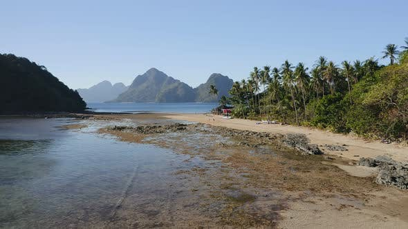 Thumbnail for Aerial Fly Along the Cas Cabanas Beach, El Nido, Palawan, Philippines, Tourists Walking on Tropical