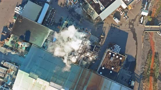 Aerial view industry chemical production building with tanks for the storage