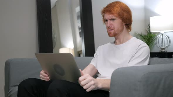 Thumbnail for Angry Yelling Redhead Man Working on Laptop in Bedroom