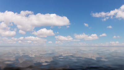 Clouds And Calm Ocean Time Lapse