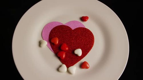 Rotating stock footage shot of Valentines decorations and candies - VALENTINES 0095