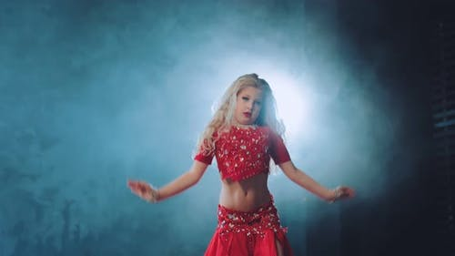 Little Beautiful Girl Dancing Oriental Dance in a Beautiful Suit with Stones