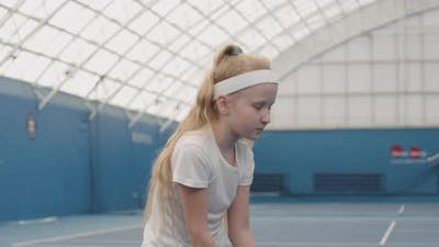 Little Girl On Tennis Training