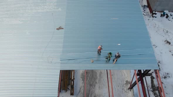 Thumbnail for Aerial Shot. Shooting From the Air. In the Frame of the Workers Are Builders, Mount the Roof