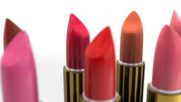 Samples of the Red Tint Lipsticks in the Golden Case on the White Background