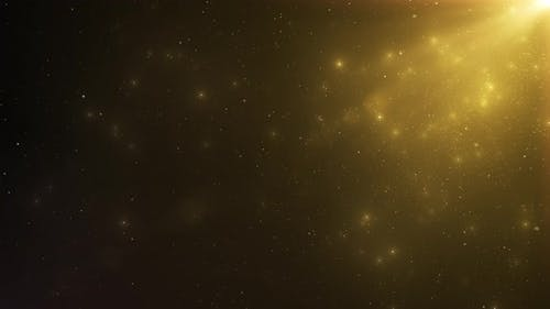 Abstract Background of Sparkling Floating Golden Dust Particles