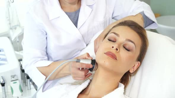 Thumbnail for Cosmetologist Makes Facial Massage with Special Equipment