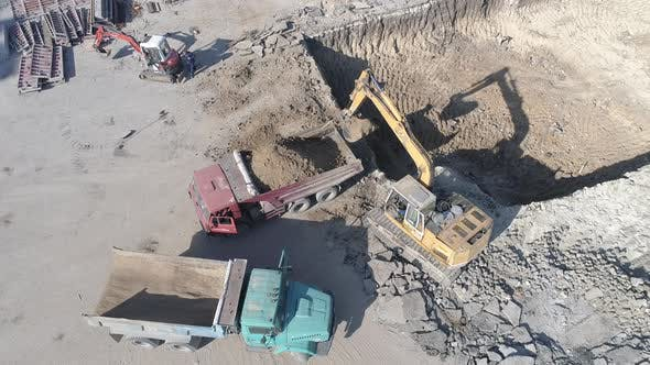 Aerial of an excavator digging a foundation