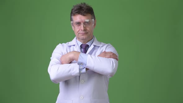 Cover Image for Mature Handsome Man Doctor Against Green Background