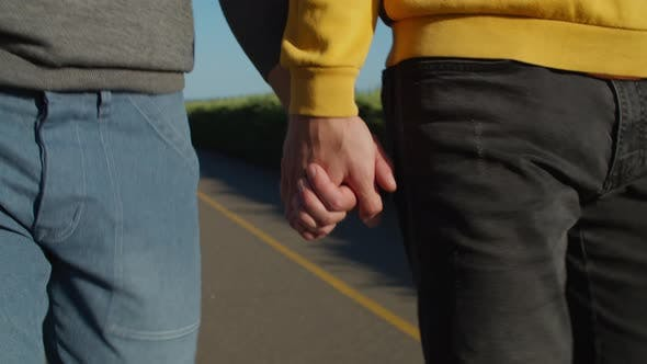 Thumbnail for Close-up of Happy Gay Couple Holding Hands Outdoor