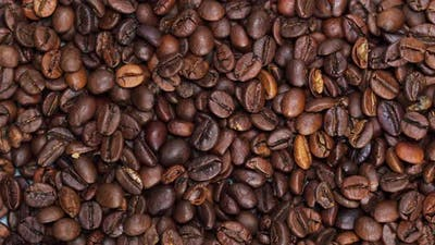 Closeup of Rotating Coffee Beans on Table