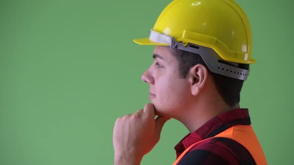 Thumbnail for Closeup Profile View of Happy Young Multi Ethnic Man Construction Worker Thinking