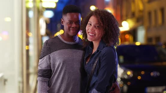 Thumbnail for Happy African American couple pose for a portrait in the city at night