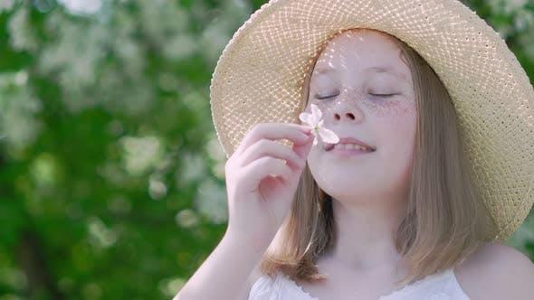 Thumbnail for Portrait Romantic Girl Sniffing Flavor Apple Flowers in Blooming Garden. Beautiful Teen Girl