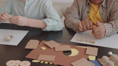 Children Making Plasticine Crafts