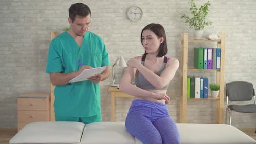 Young Woman Doctor's Chiropractor Osteopath Complains Pain Forearm