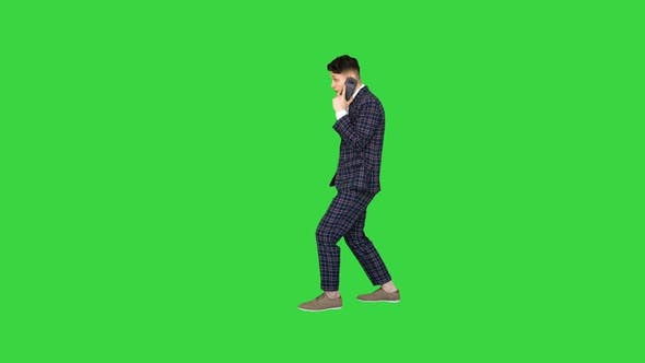 Thumbnail for Inspired Man in Formal Receiving Good News on the Phone and Dancing After on a Green Screen, Chroma
