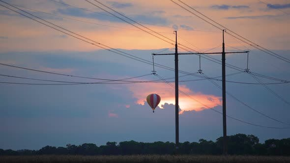 Thumbnail for Fantastic view of huge hot air balloon flying over field at sunset, dreams