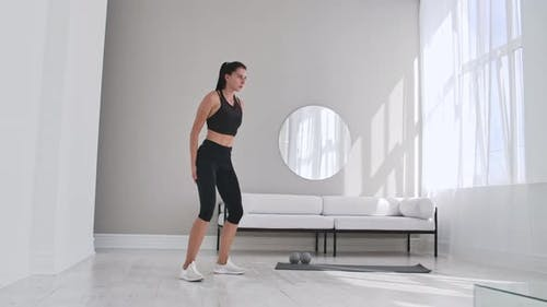 Beautiful Slim Woman in Thirties with Fair Complexion Does Morning Strenth and Aerobic Burpee