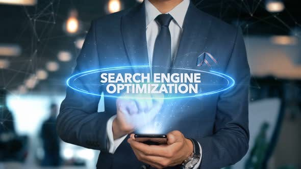 Thumbnail for Businessman Smartphone Hologram Word   Search Engine Optimization