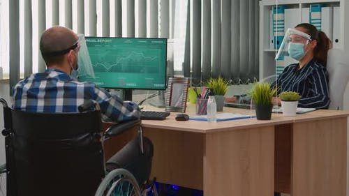 Financial Worker in Wheelchair Respecting Social Distance