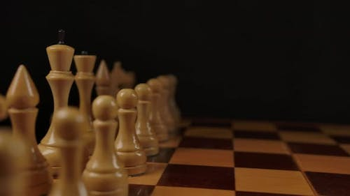 Panning Shot of Wooden Chess in Beginning Position