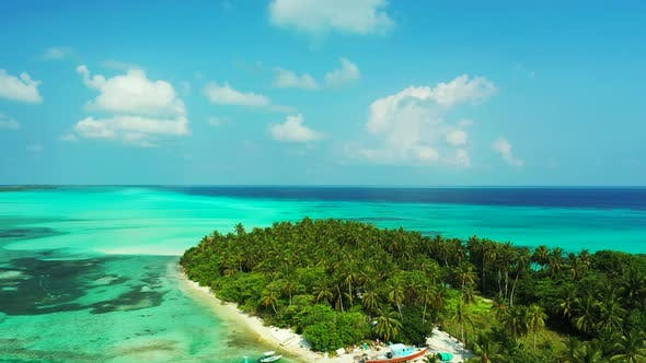 Thumbnail for Wide angle drone tourism shot of a sandy white paradise beach and aqua blue ocean background in vibr