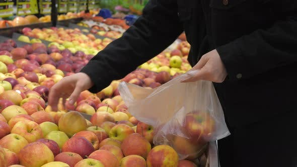 Thumbnail for Woman Buying And Picking Apple At Supermarket Using Plastic Bag.