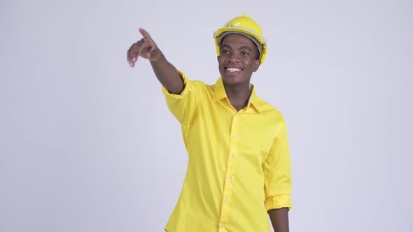 Thumbnail for Young Happy African Businessman As Engineer Pointing Finger