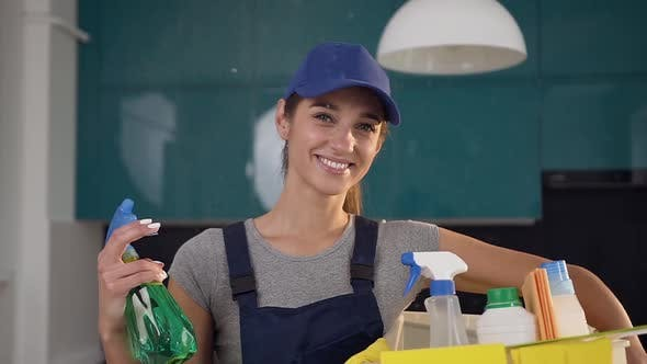 Thumbnail for Beautiful Woman with Cute Smile from Cleaning Service Standing in the Contemporary Cuisine