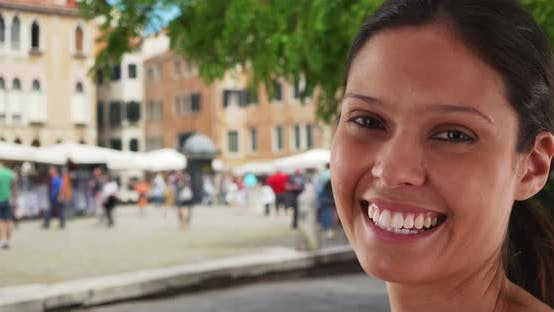 Thumbnail for Closeup portrait of beautiful tourist woman on street in Venice enjoying holiday