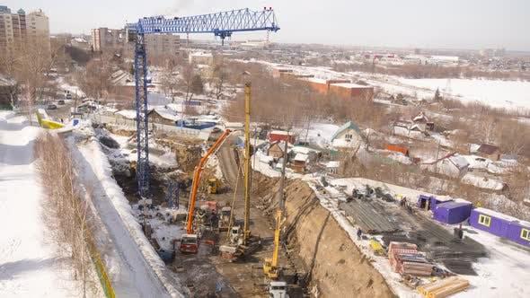 Crane and Building Construction Site