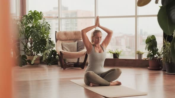 Concentrated Woman Meditating During Yoga Practice