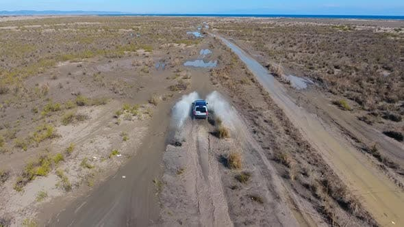 Thumbnail for Car Passing Through Puddle, Aerial Following