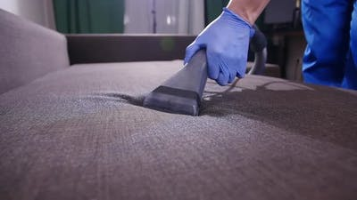 Home and Office Cleaning Concept. Professional Wet Sofa Cleaning