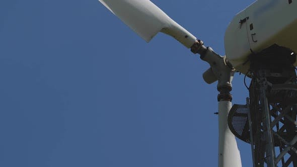 Thumbnail for Wind Turbine Blades Slow Rotation on Blue Sky Background