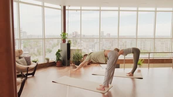 Pair Yoga Training Indoors