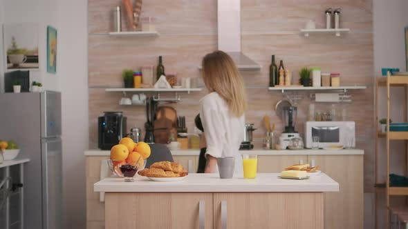 Seductive Woman Preparing Breakfast