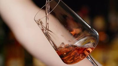 Barman Pours Rose Wine to the Wine Glass at the Bar Counter in Slow Motion  120Fps Prores HQ