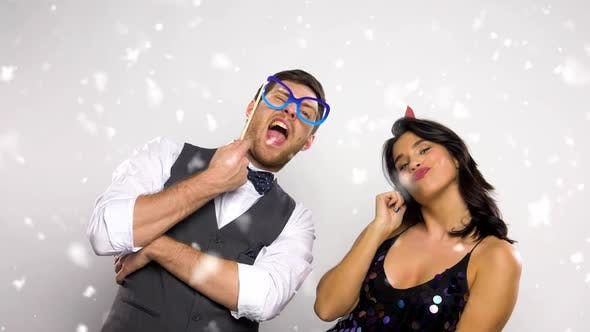 Thumbnail for Couple with Party Props on Christmas or New Year