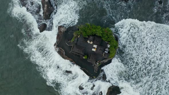Overhead Top Down View of Tanah Lot Temple Surrounded By Dangerous Sea Waves